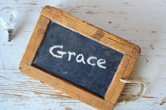 blackboard with the word Grace written on it